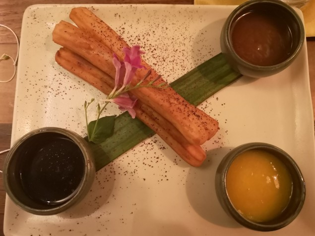 Churros with table & barako sauce, peach mango sauce, and coco-caramel sauce (from Banahaw set) Personal favorite is the peach mango sauce